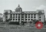 Image of 155mm howitzers next to capitol building Seoul South Korea, 1951, second 9 stock footage video 65675032641