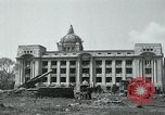 Image of 155mm howitzers next to capitol building Seoul South Korea, 1951, second 11 stock footage video 65675032641
