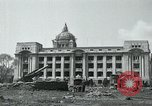 Image of 155mm howitzers next to capitol building Seoul South Korea, 1951, second 13 stock footage video 65675032641