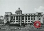 Image of 155mm howitzers next to capitol building Seoul South Korea, 1951, second 14 stock footage video 65675032641
