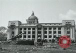 Image of 155mm howitzers next to capitol building Seoul South Korea, 1951, second 15 stock footage video 65675032641