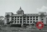 Image of 155mm howitzers next to capitol building Seoul South Korea, 1951, second 16 stock footage video 65675032641