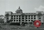Image of 155mm howitzers next to capitol building Seoul South Korea, 1951, second 17 stock footage video 65675032641