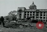 Image of 155mm howitzers next to capitol building Seoul South Korea, 1951, second 21 stock footage video 65675032641