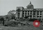 Image of 155mm howitzers next to capitol building Seoul South Korea, 1951, second 22 stock footage video 65675032641