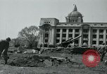 Image of 155mm howitzers next to capitol building Seoul South Korea, 1951, second 23 stock footage video 65675032641