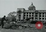 Image of 155mm howitzers next to capitol building Seoul South Korea, 1951, second 24 stock footage video 65675032641