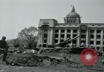Image of 155mm howitzers next to capitol building Seoul South Korea, 1951, second 25 stock footage video 65675032641