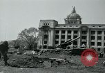 Image of 155mm howitzers next to capitol building Seoul South Korea, 1951, second 26 stock footage video 65675032641