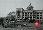 Image of 155mm howitzers next to capitol building Seoul South Korea, 1951, second 27 stock footage video 65675032641