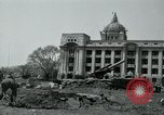 Image of 155mm howitzers next to capitol building Seoul South Korea, 1951, second 28 stock footage video 65675032641