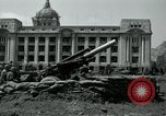 Image of 155mm howitzers next to capitol building Seoul South Korea, 1951, second 29 stock footage video 65675032641
