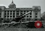 Image of 155mm howitzers next to capitol building Seoul South Korea, 1951, second 30 stock footage video 65675032641