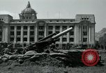 Image of 155mm howitzers next to capitol building Seoul South Korea, 1951, second 31 stock footage video 65675032641