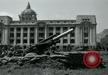 Image of 155mm howitzers next to capitol building Seoul South Korea, 1951, second 32 stock footage video 65675032641
