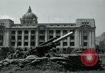 Image of 155mm howitzers next to capitol building Seoul South Korea, 1951, second 33 stock footage video 65675032641