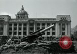 Image of 155mm howitzers next to capitol building Seoul South Korea, 1951, second 34 stock footage video 65675032641