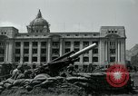 Image of 155mm howitzers next to capitol building Seoul South Korea, 1951, second 35 stock footage video 65675032641
