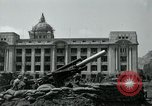 Image of 155mm howitzers next to capitol building Seoul South Korea, 1951, second 36 stock footage video 65675032641