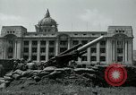 Image of 155mm howitzers next to capitol building Seoul South Korea, 1951, second 37 stock footage video 65675032641