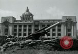 Image of 155mm howitzers next to capitol building Seoul South Korea, 1951, second 38 stock footage video 65675032641