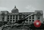 Image of 155mm howitzers next to capitol building Seoul South Korea, 1951, second 39 stock footage video 65675032641
