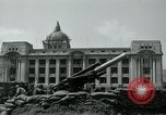 Image of 155mm howitzers next to capitol building Seoul South Korea, 1951, second 40 stock footage video 65675032641