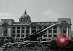 Image of 155mm howitzers next to capitol building Seoul South Korea, 1951, second 41 stock footage video 65675032641
