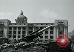 Image of 155mm howitzers next to capitol building Seoul South Korea, 1951, second 42 stock footage video 65675032641