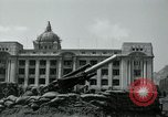 Image of 155mm howitzers next to capitol building Seoul South Korea, 1951, second 43 stock footage video 65675032641