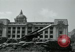 Image of 155mm howitzers next to capitol building Seoul South Korea, 1951, second 45 stock footage video 65675032641