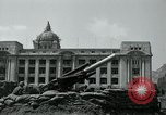 Image of 155mm howitzers next to capitol building Seoul South Korea, 1951, second 46 stock footage video 65675032641