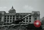 Image of 155mm howitzers next to capitol building Seoul South Korea, 1951, second 47 stock footage video 65675032641
