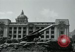 Image of 155mm howitzers next to capitol building Seoul South Korea, 1951, second 48 stock footage video 65675032641