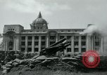 Image of 155mm howitzers next to capitol building Seoul South Korea, 1951, second 49 stock footage video 65675032641