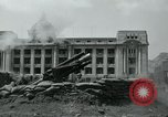 Image of 155mm howitzers next to capitol building Seoul South Korea, 1951, second 50 stock footage video 65675032641