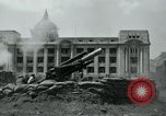 Image of 155mm howitzers next to capitol building Seoul South Korea, 1951, second 51 stock footage video 65675032641