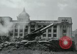 Image of 155mm howitzers next to capitol building Seoul South Korea, 1951, second 52 stock footage video 65675032641