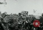 Image of Viet Cong watching U.S. soldiers in Jeep Vietnam, 1965, second 6 stock footage video 65675032686