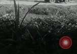 Image of Viet Cong watching U.S. soldiers in Jeep Vietnam, 1965, second 17 stock footage video 65675032686