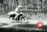 Image of Vietnamese people leaving a damaged Viet Cong camp Vietnam, 1965, second 18 stock footage video 65675032689