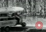Image of Vietnamese people leaving a damaged Viet Cong camp Vietnam, 1965, second 20 stock footage video 65675032689