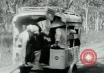 Image of Vietnamese people leaving a damaged Viet Cong camp Vietnam, 1965, second 23 stock footage video 65675032689