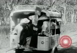 Image of Vietnamese people leaving a damaged Viet Cong camp Vietnam, 1965, second 24 stock footage video 65675032689