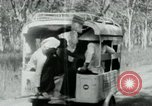 Image of Vietnamese people leaving a damaged Viet Cong camp Vietnam, 1965, second 25 stock footage video 65675032689
