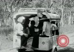 Image of Vietnamese people leaving a damaged Viet Cong camp Vietnam, 1965, second 26 stock footage video 65675032689