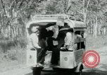 Image of Vietnamese people leaving a damaged Viet Cong camp Vietnam, 1965, second 27 stock footage video 65675032689