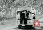 Image of Vietnamese people leaving a damaged Viet Cong camp Vietnam, 1965, second 28 stock footage video 65675032689