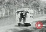 Image of Vietnamese people leaving a damaged Viet Cong camp Vietnam, 1965, second 29 stock footage video 65675032689