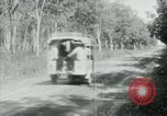 Image of Vietnamese people leaving a damaged Viet Cong camp Vietnam, 1965, second 30 stock footage video 65675032689